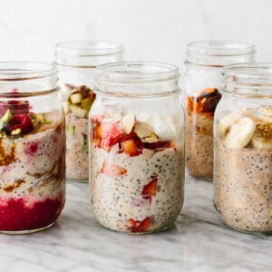 Six jars of overnight oats.