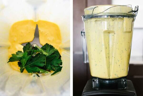 Blending hollandaise sauce in a Vitamix with parsley.