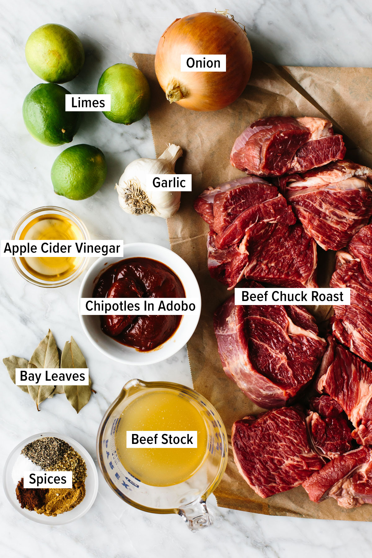Ingredients for beef barbacoa on a table.