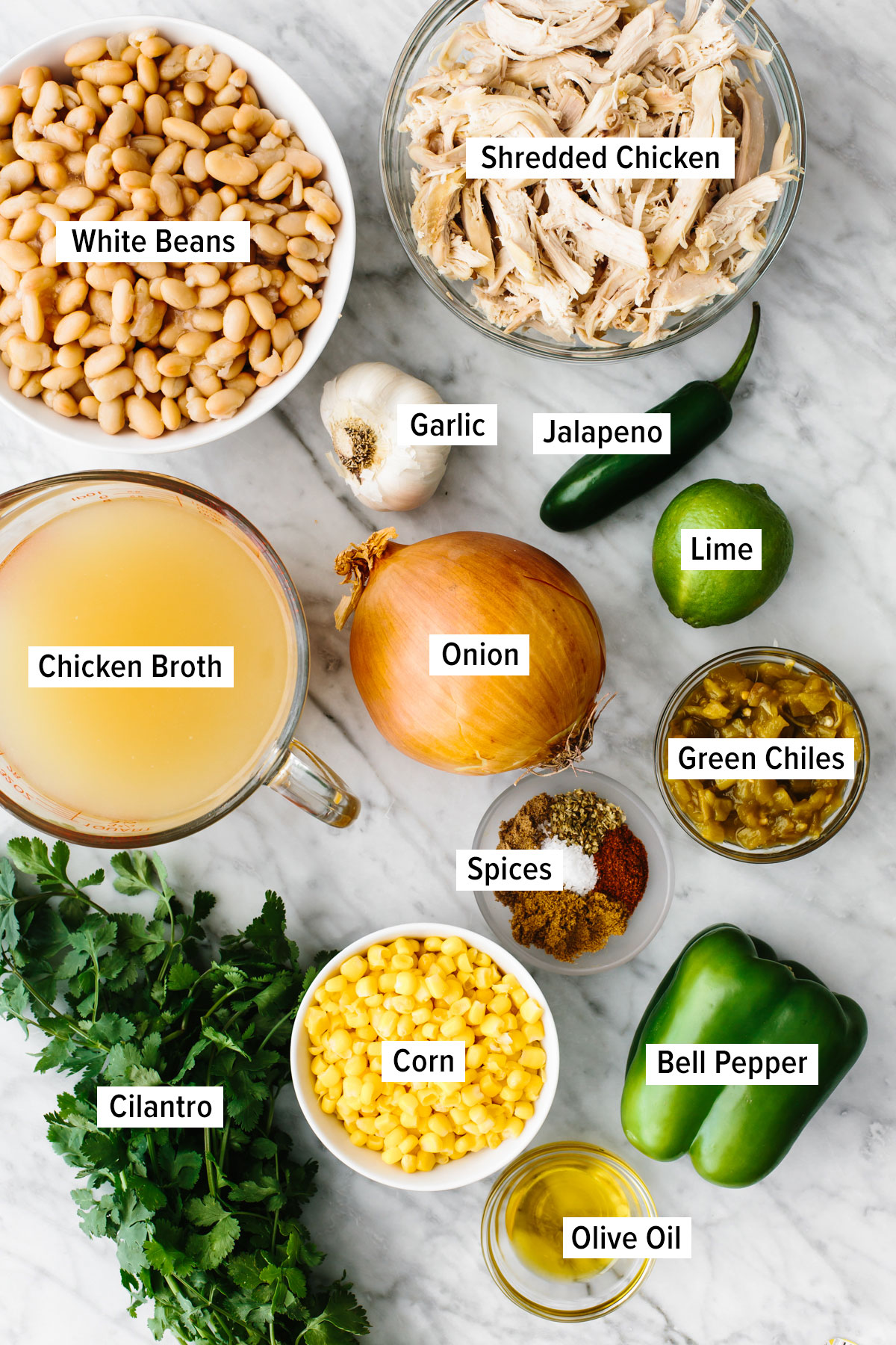 Ingredients for white chicken chili on a table.
