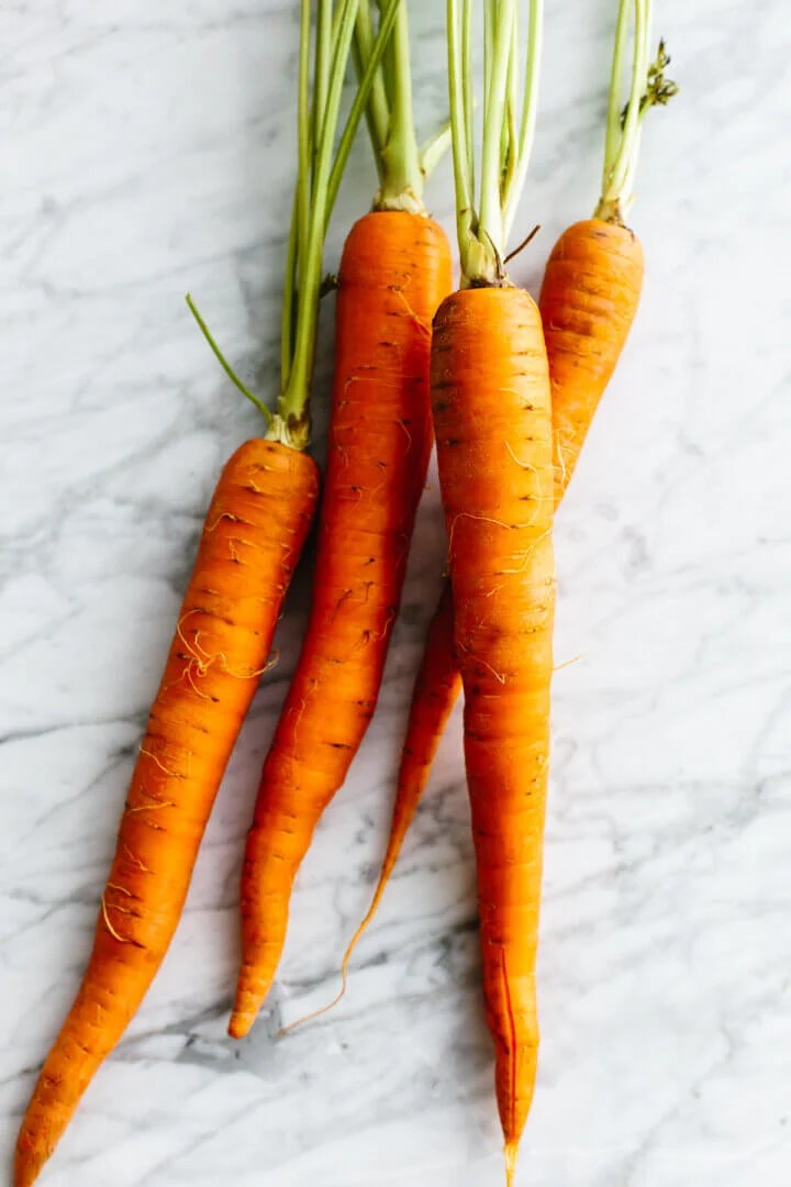 Carrots on a table for carrot cake.