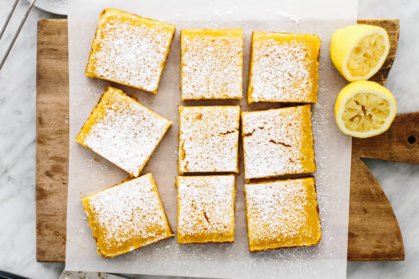 Lemon bar slices on a board.