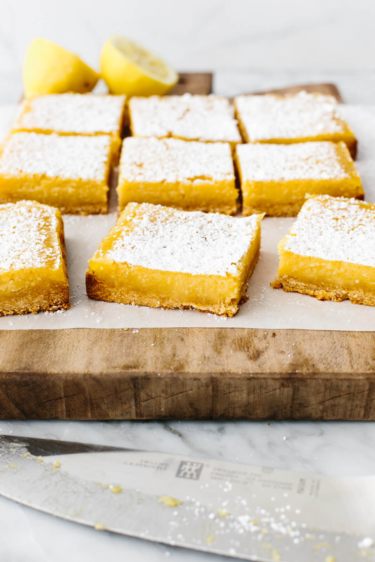 Gluten-free lemon bars on a wooden board.
