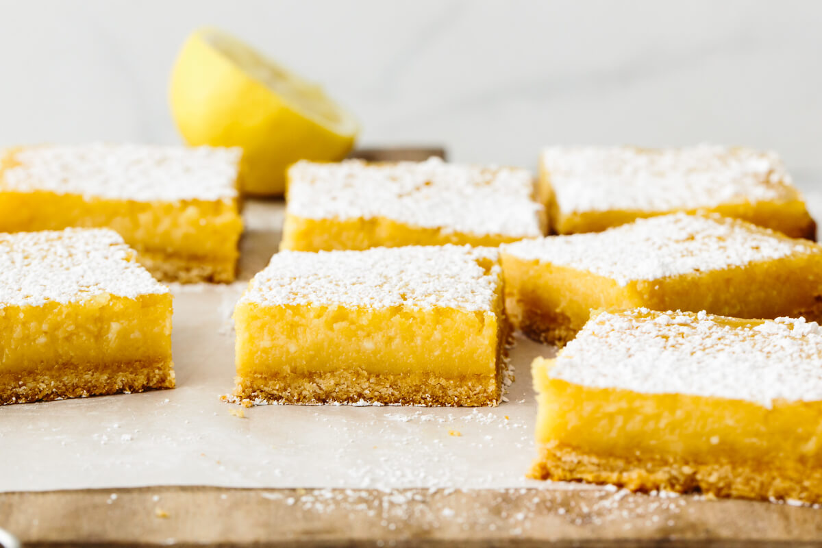 A wooden board with gluten-free lemon bars