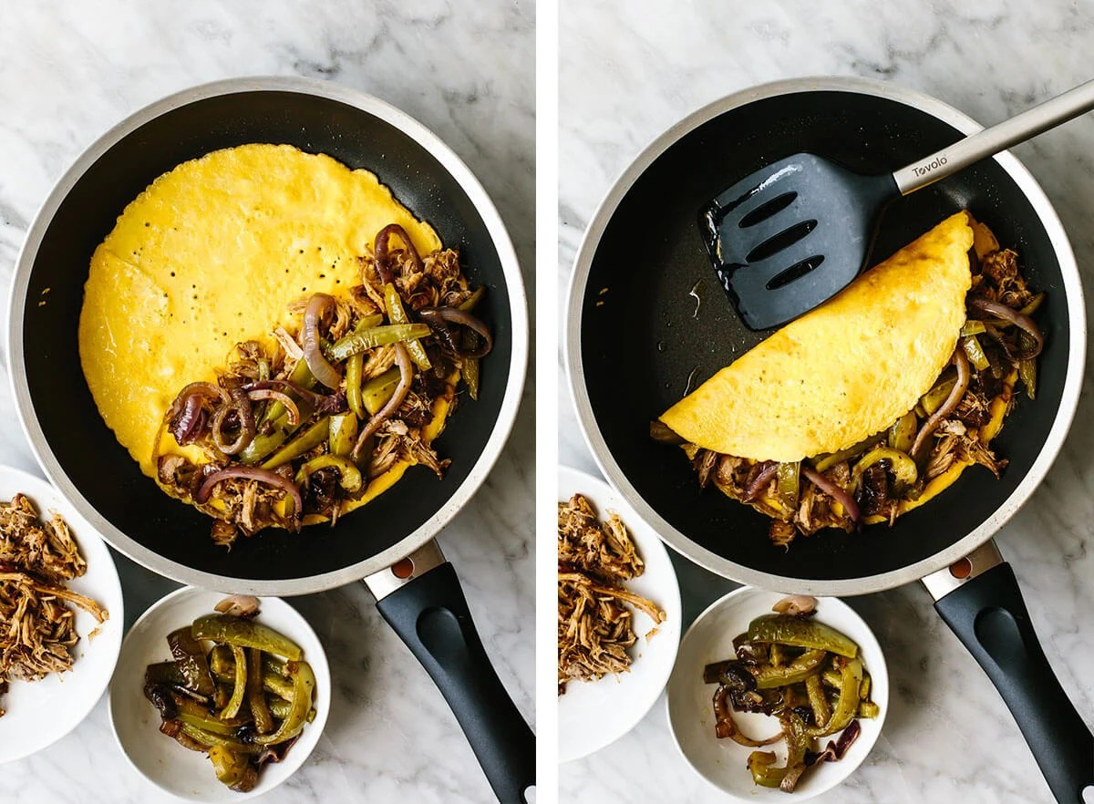 Making a carnitas omelette in a pan.
