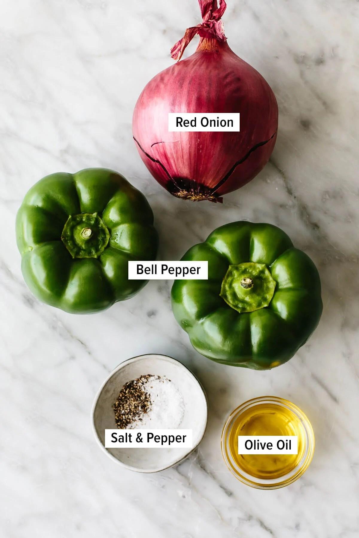 Ingredients for fajita veggies on a table.