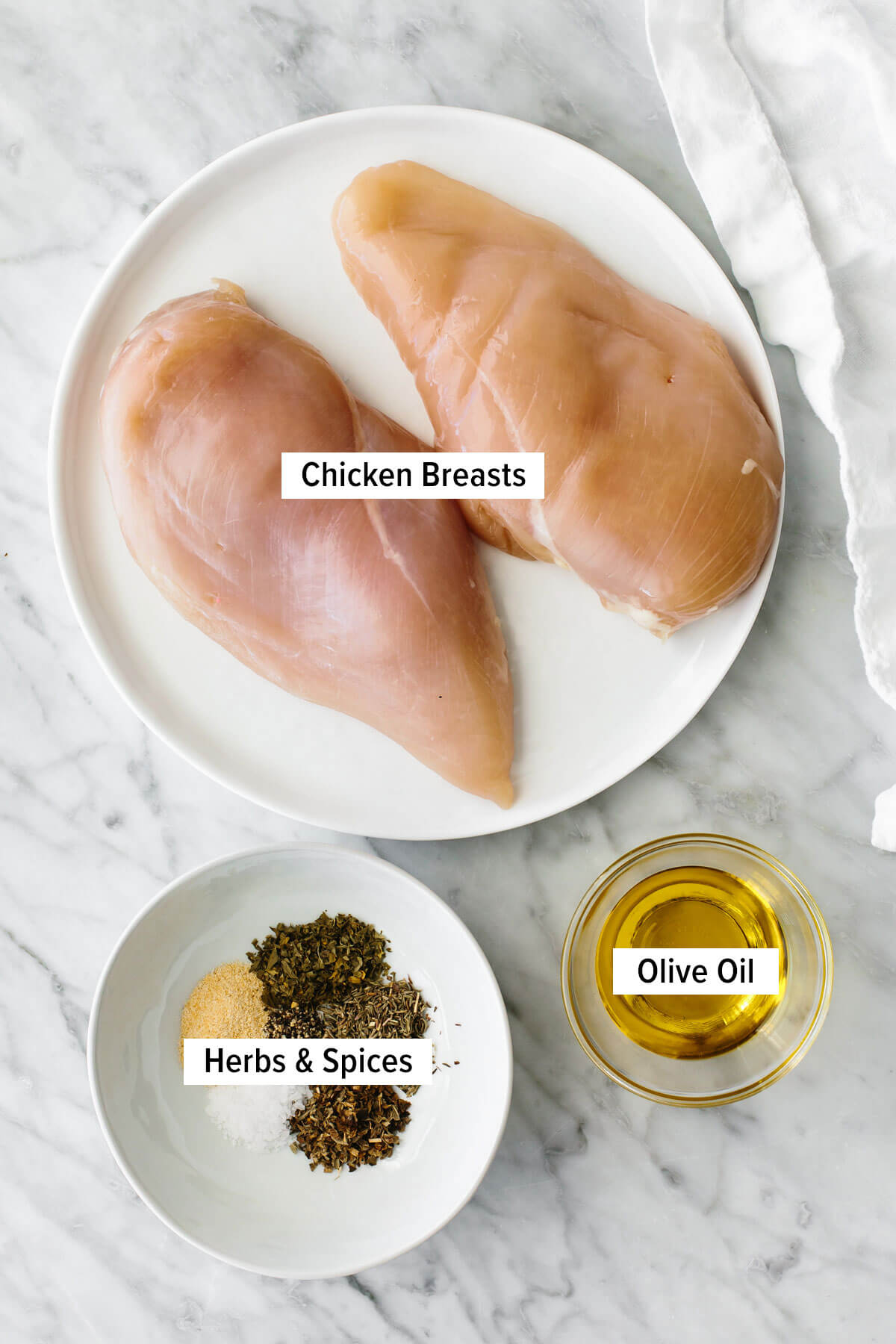 Ingredients for herb baked chicken on a table.