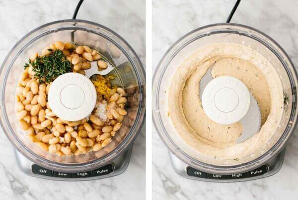A food processor blending a white bean dip.