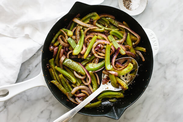 A skillet with sauteed fajita veggies