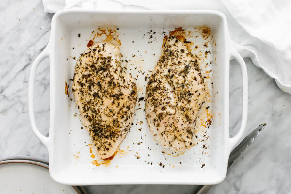 Baked chicken breasts in a baking dish.