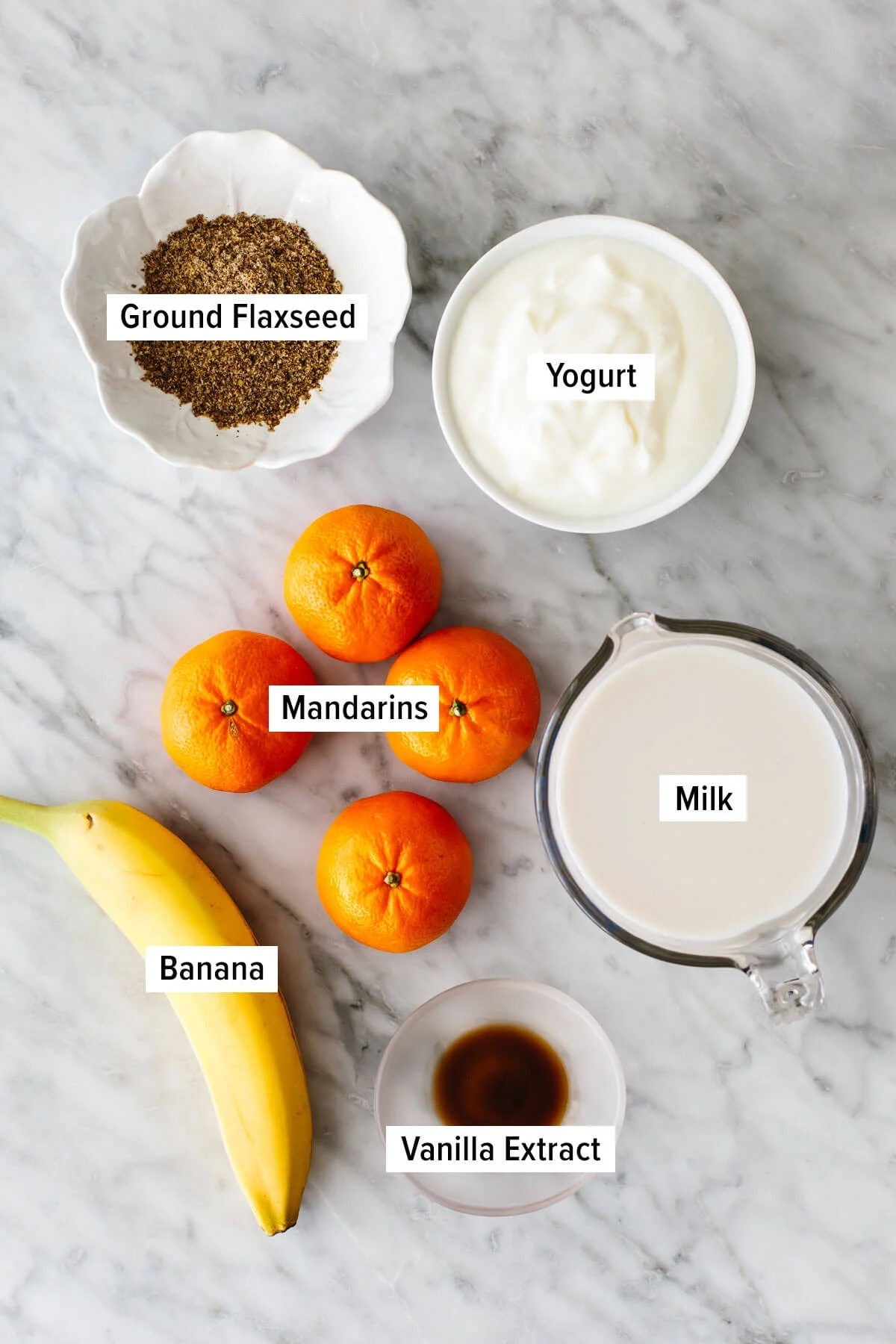 Ingredients for a mandarin breakfast smoothie on a table.