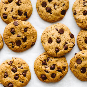 Gluten-free chocolate chip cookies scattered.
