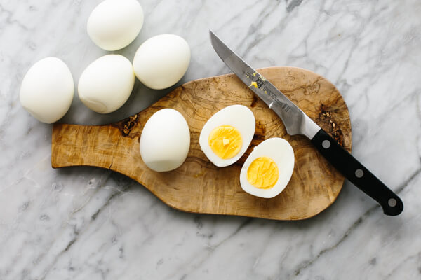 Slicing eggs in half for smoked salmon deviled eggs