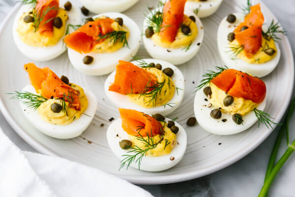 Smoked salmon deviled eggs with capers and dill.