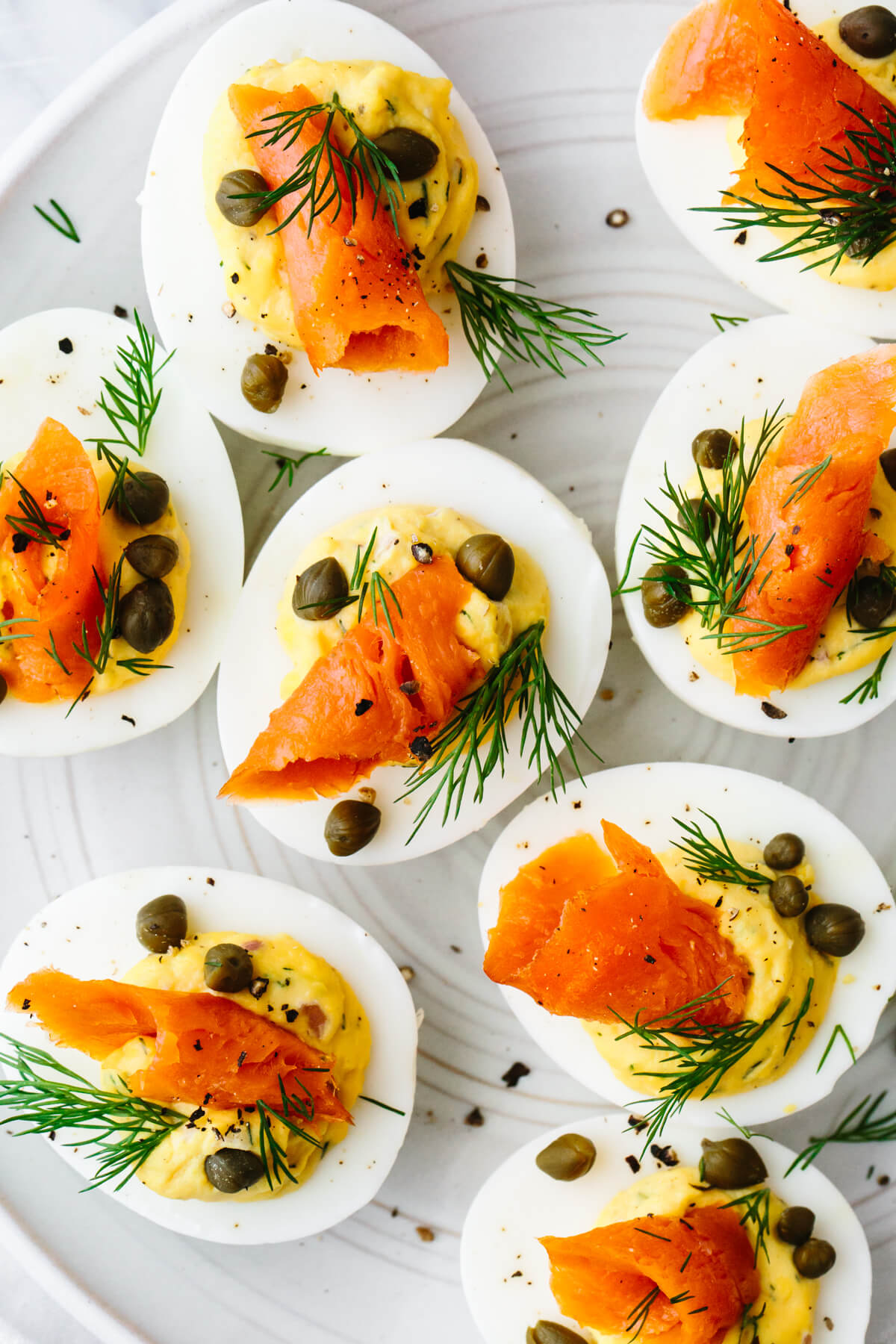 Smoked salmon deviled eggs on a plate.