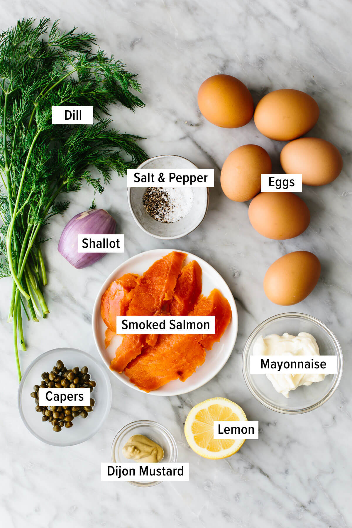 Ingredients for smoked salmon deviled eggs on a table.