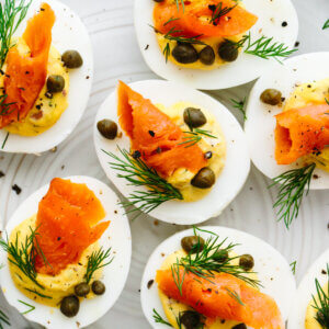 Smoked salmon deviled eggs filled on a plate.