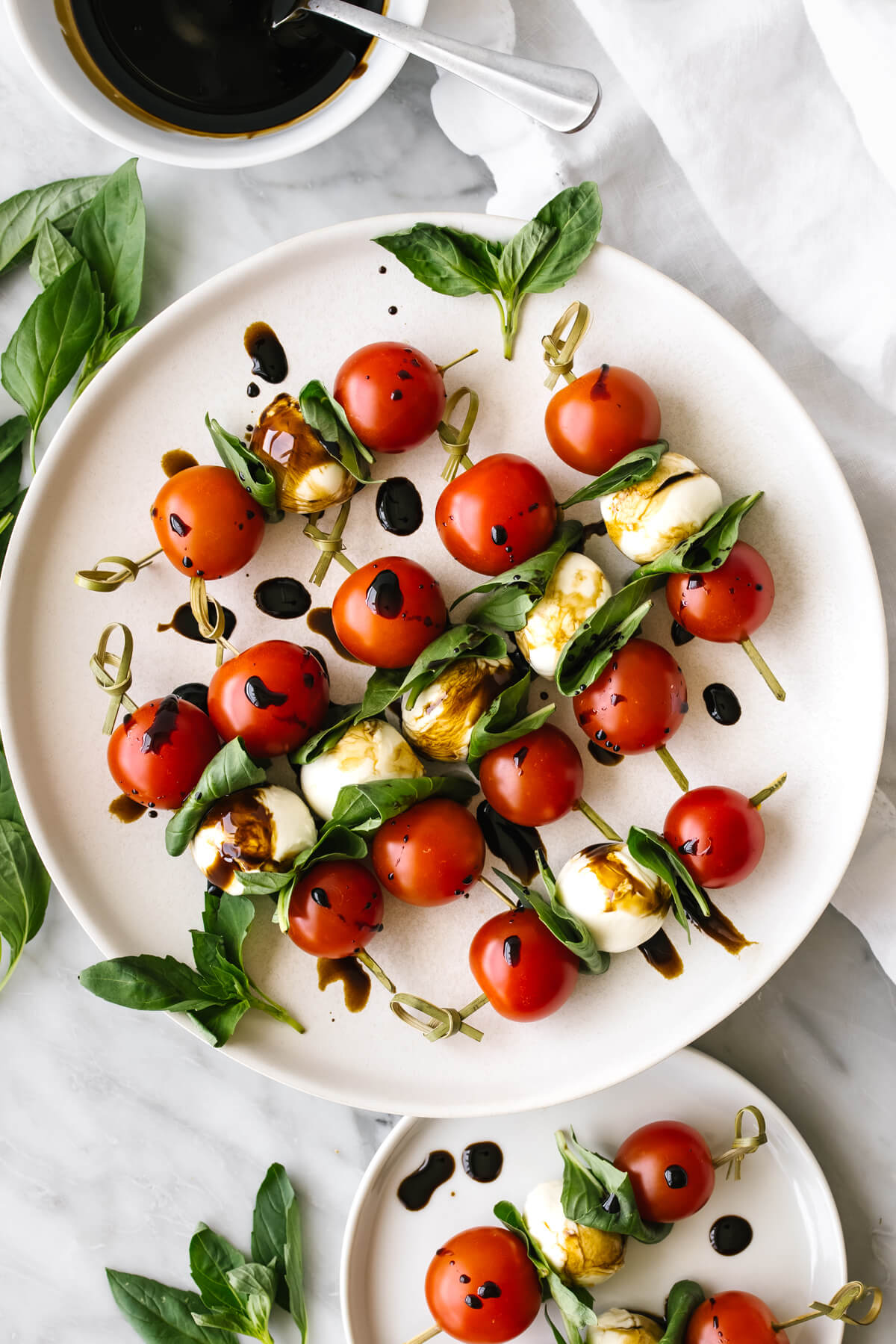 Caprese skewers on a white plate