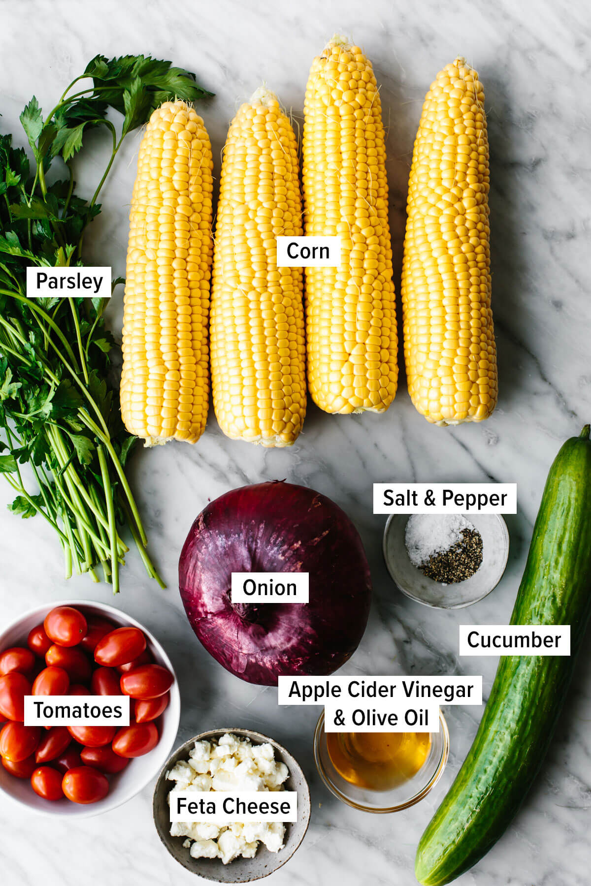 Ingredients for grilled corn salad on a table.