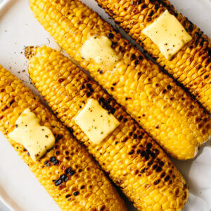 Grilled corn on the cobs with slabs of butter