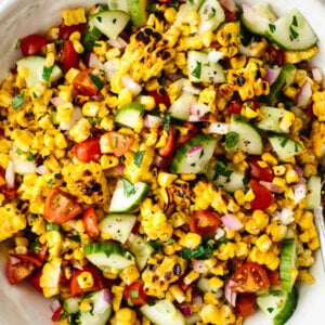 Grilled corn salad in a large white bowl
