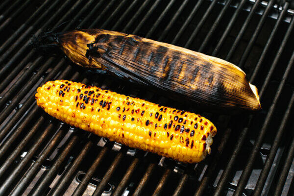 Grilling corn on the cobs on an outdoor grill