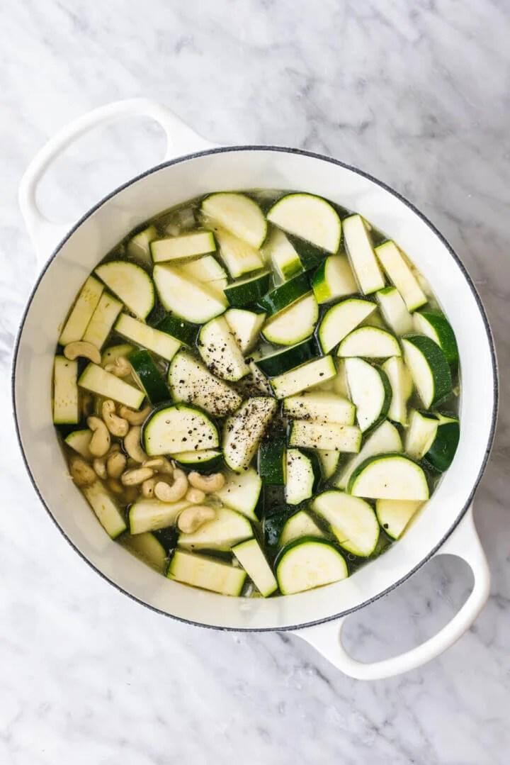 Cooking zucchini in a pot for zucchini soup.