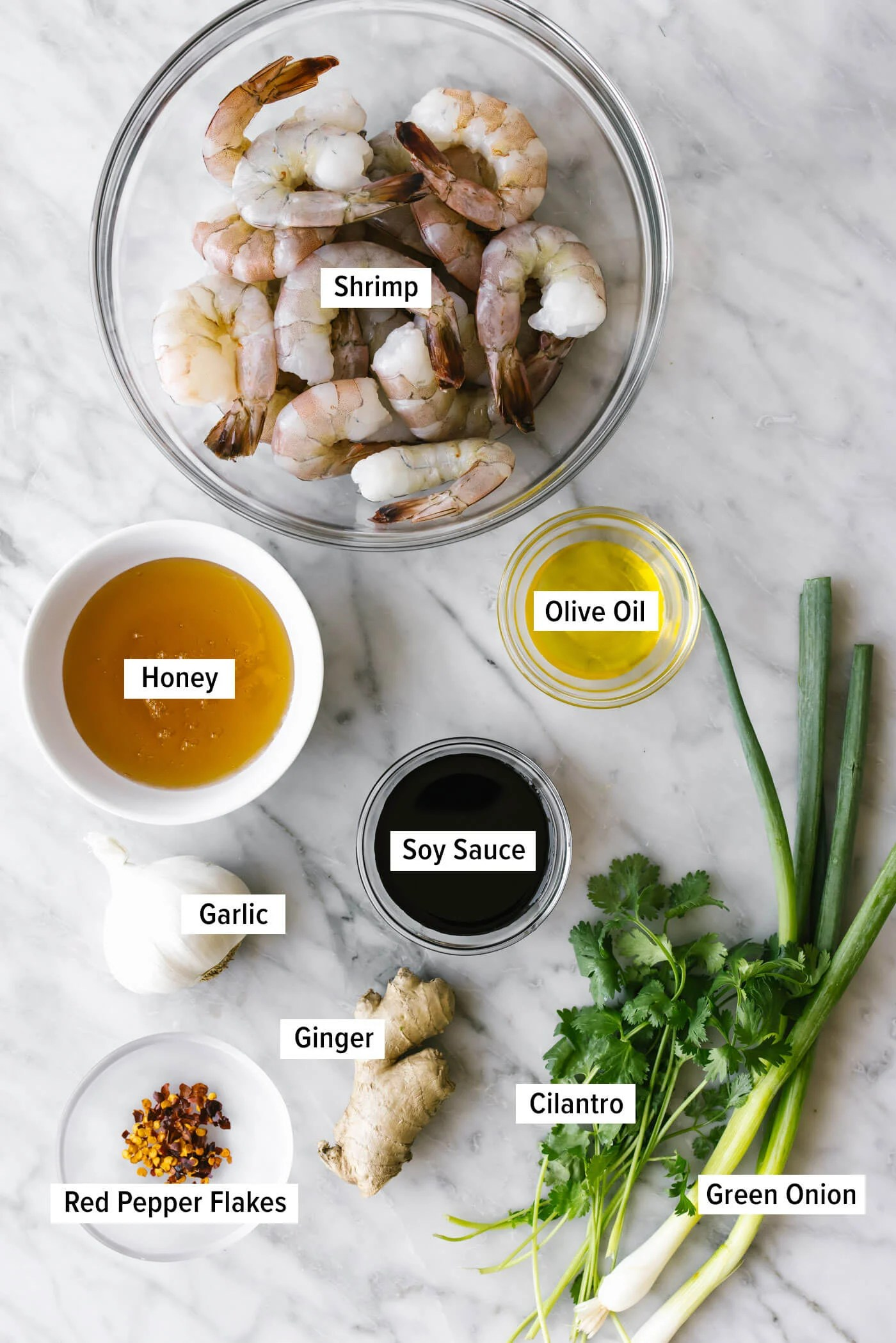 Ingredients for honey garlic shrimp on a table.