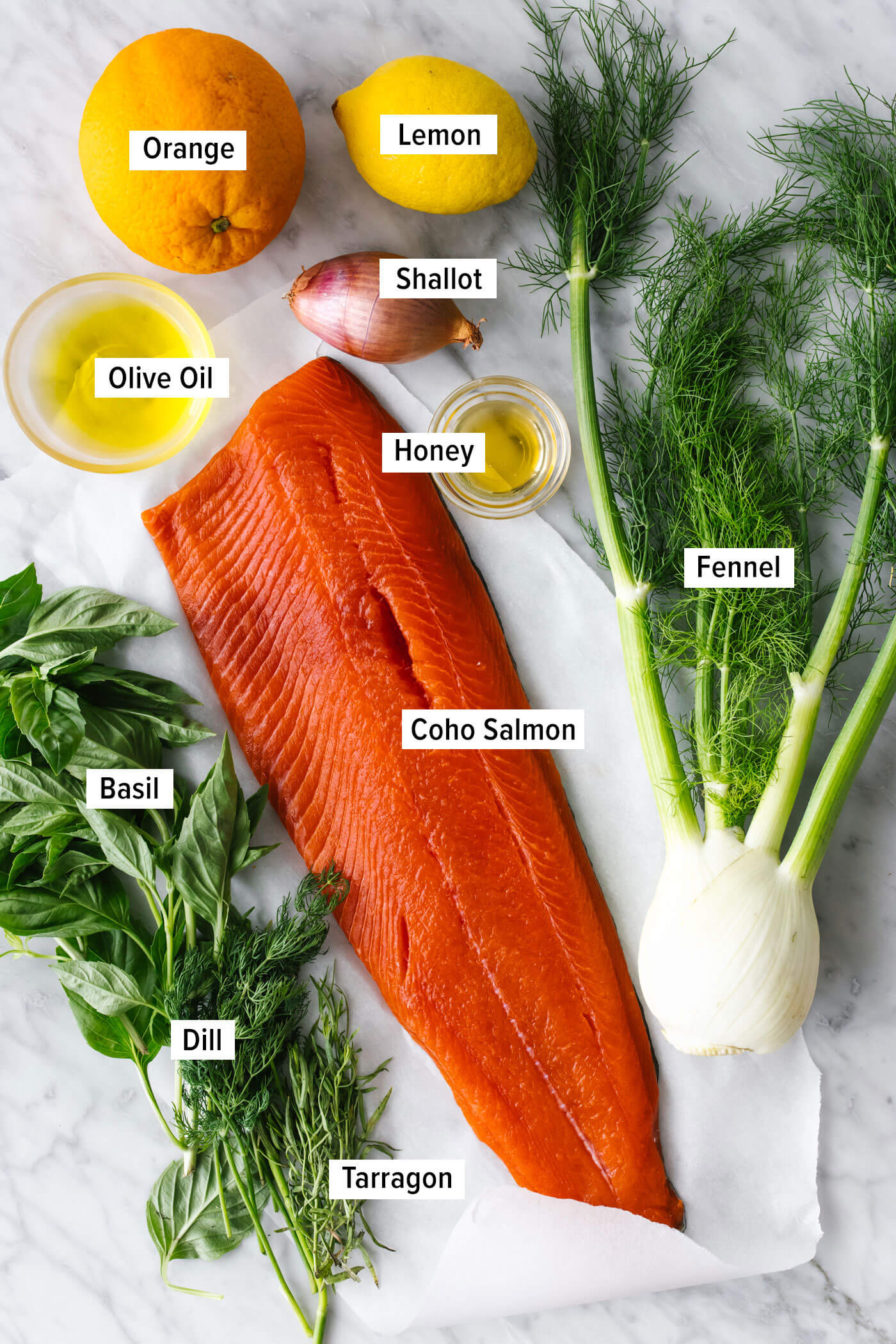 Ingredients for slow roasted salmon with fennel on a table.