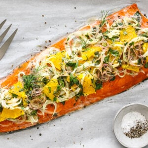 Slow roasted salmon with fennel topping next to a large fork.