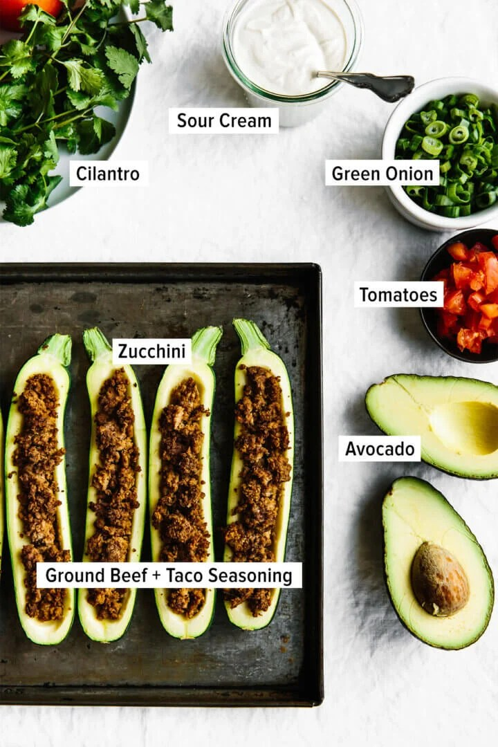 Ingredients for making taco stuffed zucchini boats on a table.