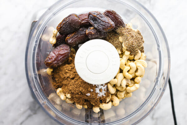 Blending mint chocolate energy ball ingredients in a food processor