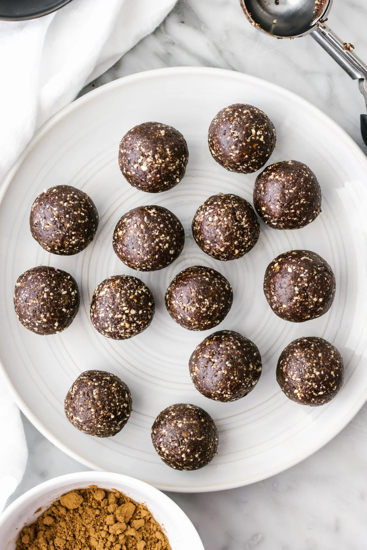 Mint chocolate energy balls on a plate.