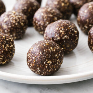 A white plate filled with mint chocolate energy balls