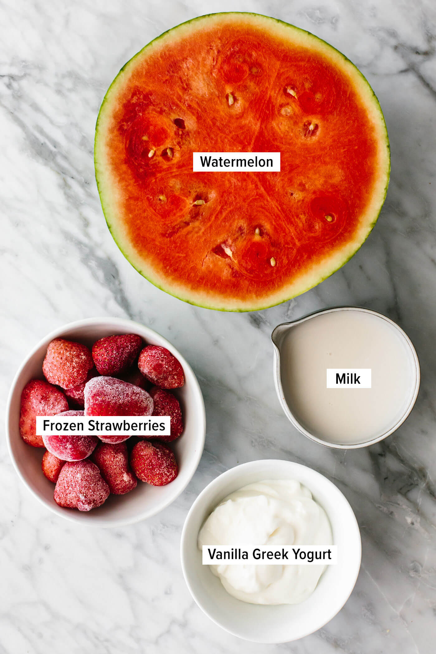 Ingredients for watermelon smoothie on a table.