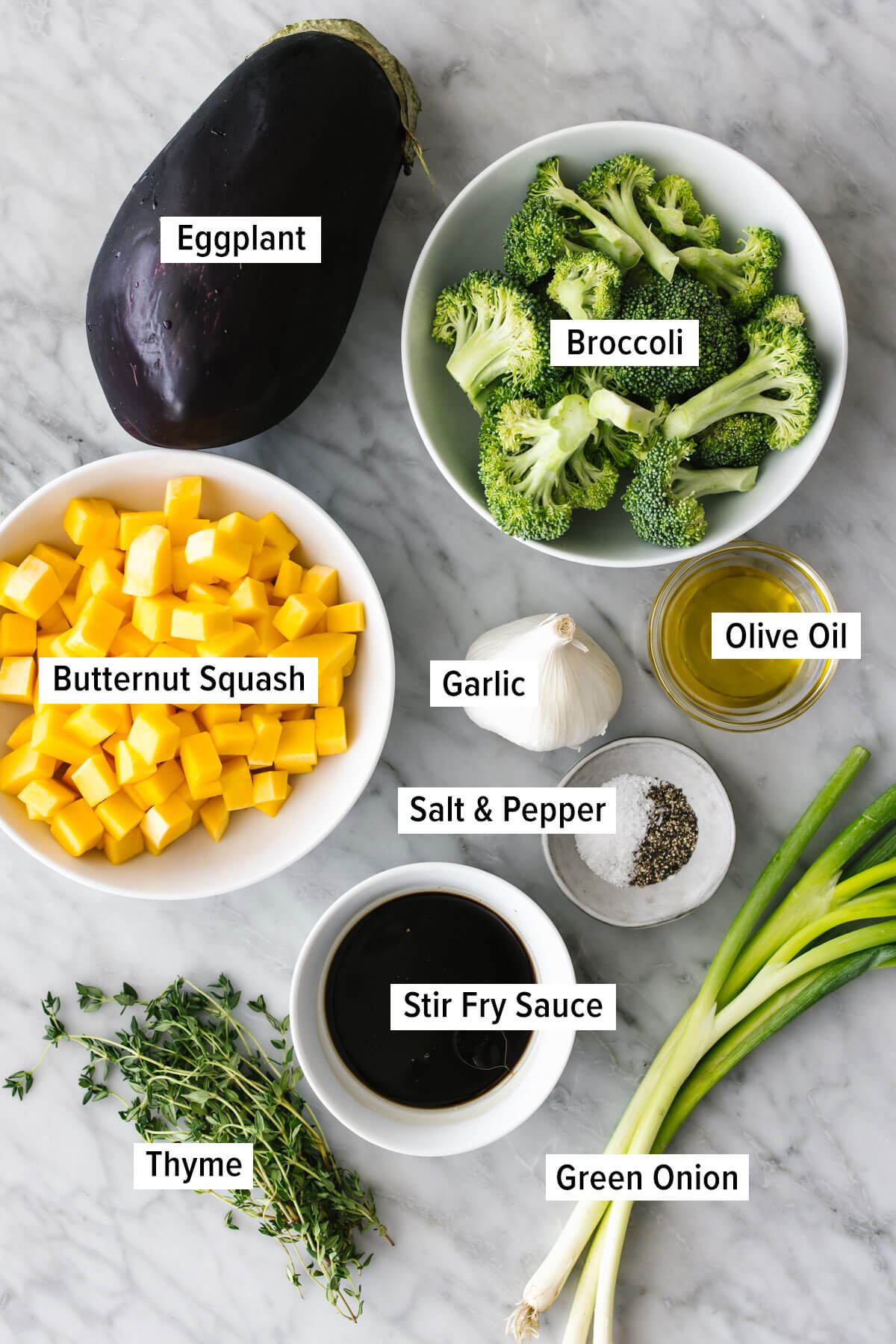 Ingredients for butternut squash and eggplant stir fry on a table
