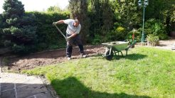 Iain hard at work digging up the turf as part of the lawn clearance.