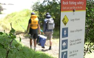 Rock fishing safety sign
