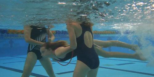 swimming through hoop underwater