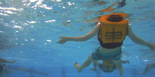 Survival backstroke wearing a lifejacket