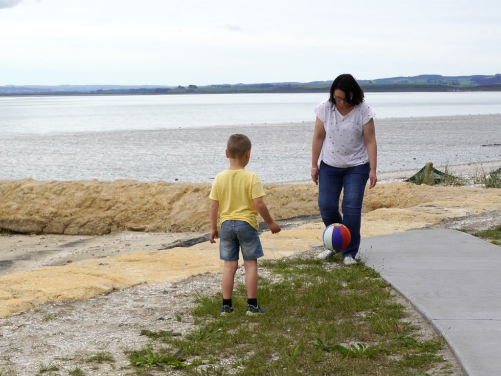 PLaying ball at the beach with Mum