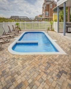 Outdoor Fiberglass Pool - DrainRooter Plumbing