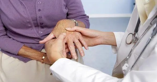 blog picture of older lady at doctors office and doctor is checking her hands