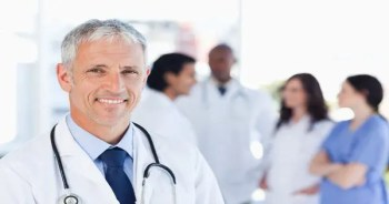blog picture of doctor smiling and other medical staff in background