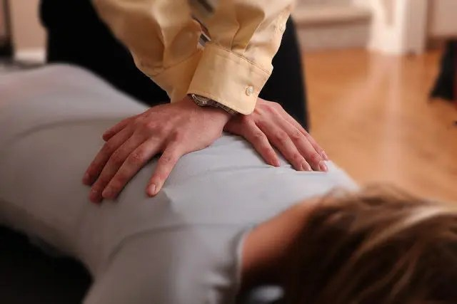 blog picture of chiropractor doing a back adjustment