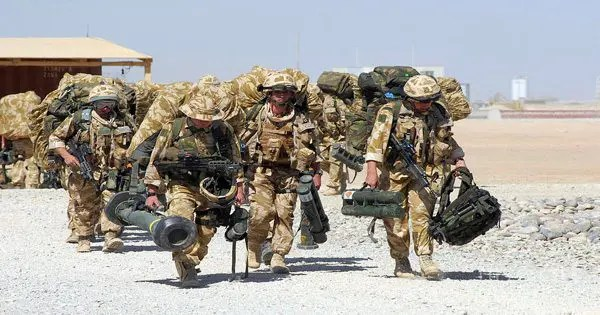 blog picture of soldiers carrying equipment