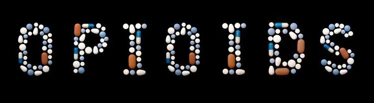 blog picture of pills spelling out the word opioids