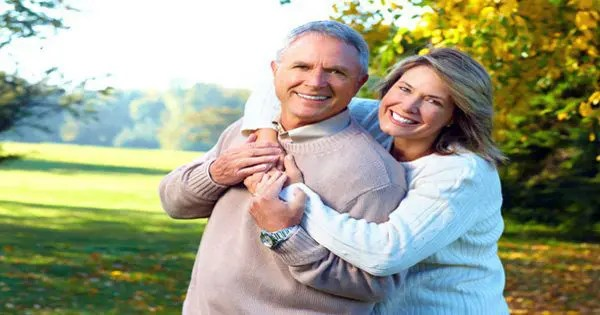 blog picture of older couple hugging in a park