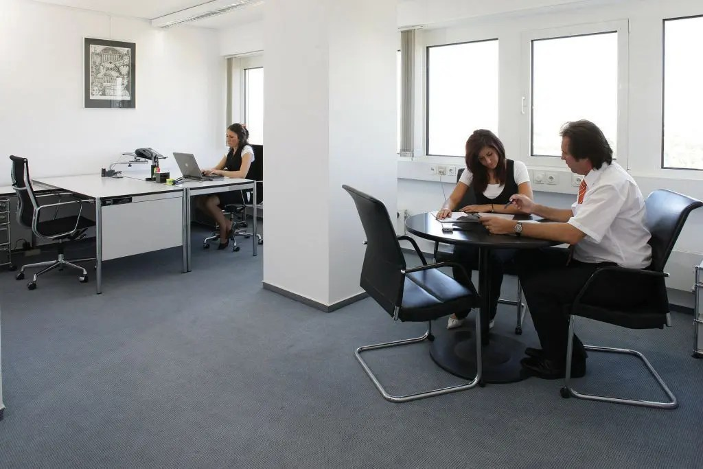 blog picture of office with three office workers