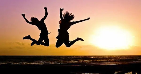 blog picture of two youths jumping during sunset